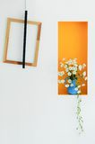 Home decoration, Wooden frame and the vase on the wall Royalty Free Stock Image