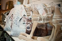 Home decorations shop interior with horses and pillows Royalty Free Stock Photos