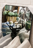 Home decorations shop interior. Home decorations shop with various items on sale, reflected in a mirror with deer design Stock Photography
