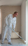 Home decorator painting wall with a roller Stock Photography