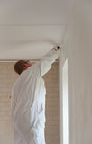 Home decorator painting a wall Royalty Free Stock Image