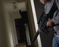 Home defense. A home owner responding to a noise in the night stock image