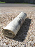 Home Delivery. Newspaper lies in residential driveway Stock Images
