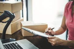 Home delivery service and working service mind, Woman working checking order to confirm before sending customer in post office royalty free stock photos