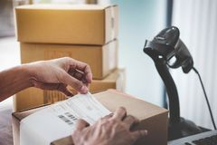 Home delivery service and working service mind, Woman working install serial barcode to confirm before sending customer in post. Office stock image