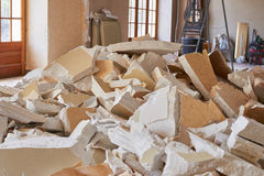 Home demolition debris. Destroyed home for demolition with equipment and debris Royalty Free Stock Photos