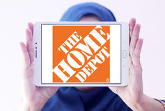 The home depot logo. Logo of the home depot on samsung tablet holded by arab muslim woman. the home depot is an American home improvement supplies retailing stock photography