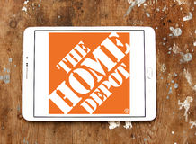 The home depot logo. Logo of the home depot on samsung tablet on wooden background. the home depot is an American home improvement supplies retailing company stock photos