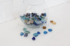 Home design - decorative glass pebbles in vase Stock Image