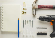 Home DIY construction work tools on white table. Construction Tools with Blank book page. Stock Photos