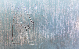 Home drawn on frozen frosty window as a symbol of fixed interest Stock Photography