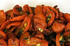 dried tomatoes. A  closeup of  dried tomatoes with garlic and herbs Royalty Free Stock Image