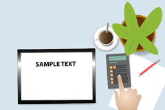 Home economics concept. Top view of the office desk with coffee cup, plant in the pot and blank paper with pen. Hand is touching calculator. Blank tablet in is Royalty Free Stock Images