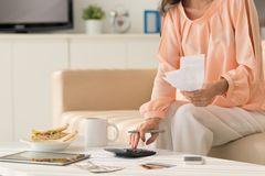 Home economics. Cropped image of woman calculating unpaid bills: home economics concept stock photos