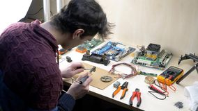 Home electronic laboratory. Tin soldering parts at workshop stock video