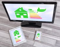 Home energy efficiency concept on different devices. Home energy efficiency concept shown on different information technology devices royalty free stock photos
