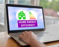 Home energy efficiency concept on a laptop. Man using a laptop with home energy efficiency concept on the screen royalty free stock images