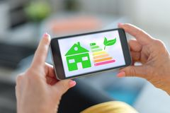 Home energy efficiency concept on a smartphone. Smartphone screen displaying a home energy efficiency concept royalty free stock image