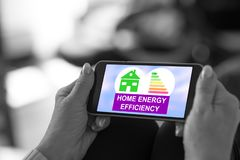 Home energy efficiency concept on a smartphone. Smartphone screen displaying a home energy efficiency concept stock image