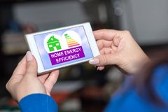 Home energy efficiency concept on a smartphone. Smartphone screen displaying a home energy efficiency concept royalty free stock photography