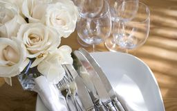 Home entertaining: flowers & sparkling dishes. In the light Stock Photos