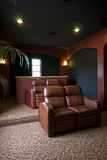 Home entertainment room. Comfortable chairs adorn this modern home's video entertainment room Stock Photo