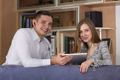 Home entertainments man and woman watch movie on Royalty Free Stock Photography