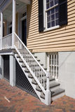 Home entrance. Wooden stair case leading to the front door of a house Royalty Free Stock Photo