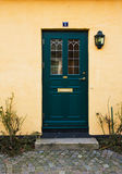Home entrance. Green door of a welcoming home Stock Photo