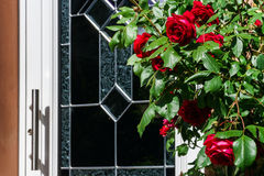 Home entrance decorated by natural roses Royalty Free Stock Photo