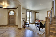 Home Entrance and Foyer. View of home's foyer and entrance with wood floors Stock Photo