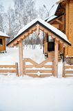 Home entrance with a wooden fence, Cabin log Stock Photography