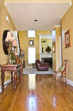 Home Entry Design. A hallway entrance in a modern home leading to the family area and stairs Stock Images
