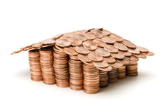Home equity. A home made of pennies on a white bacground royalty free stock photo