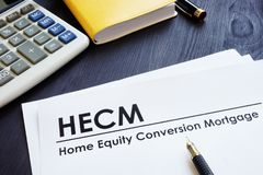 Home Equity Conversion Mortgage HECM. Home Equity Conversion Mortgage HECM on a desk royalty free stock photo