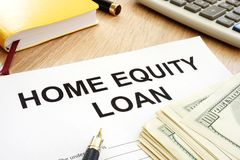 Home equity loan form and cash on a table. Home equity loan form and cash on the table royalty free stock photo