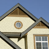 Home Exterior Details. Roof peaks and exterior siding details on a new house Royalty Free Stock Photos