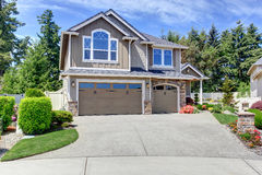 Home exterior with garage and driveway Stock Images