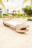 Home exterior patio. With handcraft wooden sofa with an aligator appearance Royalty Free Stock Image