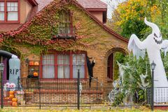 Home exterior decorated for Halloween stock images
