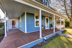 Home exterior with wrap around front porch. Stock Image
