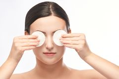 Home face care. Girl remove makeup. Woman hand with pad. Skin clean with cotton royalty free stock photos