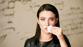 Home face care. Girl remove makeup. Woman hand with pad. Skin clean with cotton stock photos