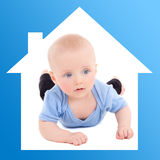 Home and family concept - baby boy in blue house. Frame Stock Photo