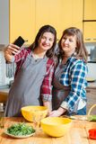 Home family leisure culinary hobby healthy food. Home family leisure. Culinary hobby. Healthy food. Mother and daughter cooking together, having fun, taking stock images