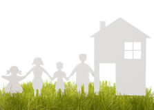 Home and family from a paper cut on the grass Stock Image