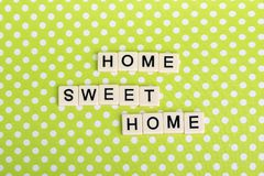 Game tiles forming family concept phrase. Home and family related sentence formed with game tile letters stock photos