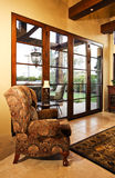 Home Family Room With Large Doors To Patio Stock Photo