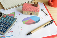 Home finance concept, residential house. Expenses calculated Royalty Free Stock Photography