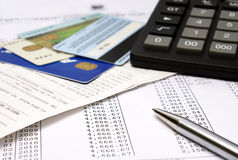 Home Finances. Heap of bills and checks, credit cards, the calculator, a ball pen Royalty Free Stock Photography